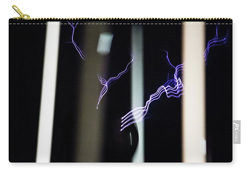 Tesla Coil Carry-all Pouch featuring the photograph Tesla Energized by Tyson Kinnison