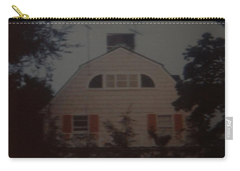 The Amityville Horror Carry-all Pouch featuring the photograph The Amityville Horror by Rob Hans