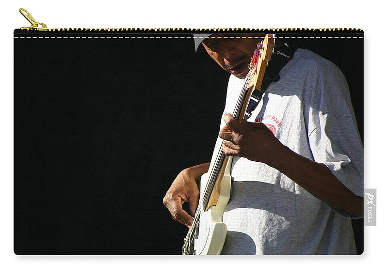 Guitar Carry-all Pouch featuring the photograph The Bassman by Joe Kozlowski