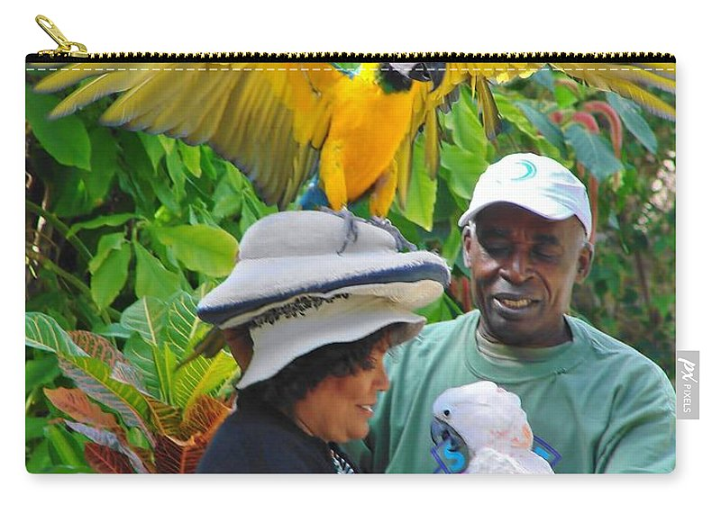 Ardastra Gardens Carry-all Pouch featuring the photograph The Bird Lady At Ardastra Gardens by Margaret Bobb