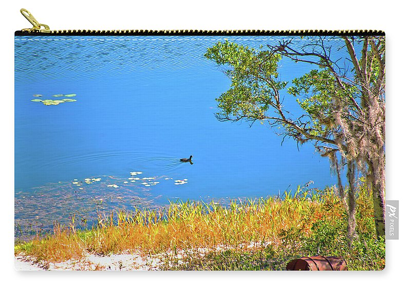 Lake Carry-all Pouch featuring the photograph The Duck by Gina O'Brien