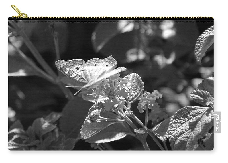 Black And White Carry-all Pouch featuring the photograph The Eagle Has Landed by Rob Hans