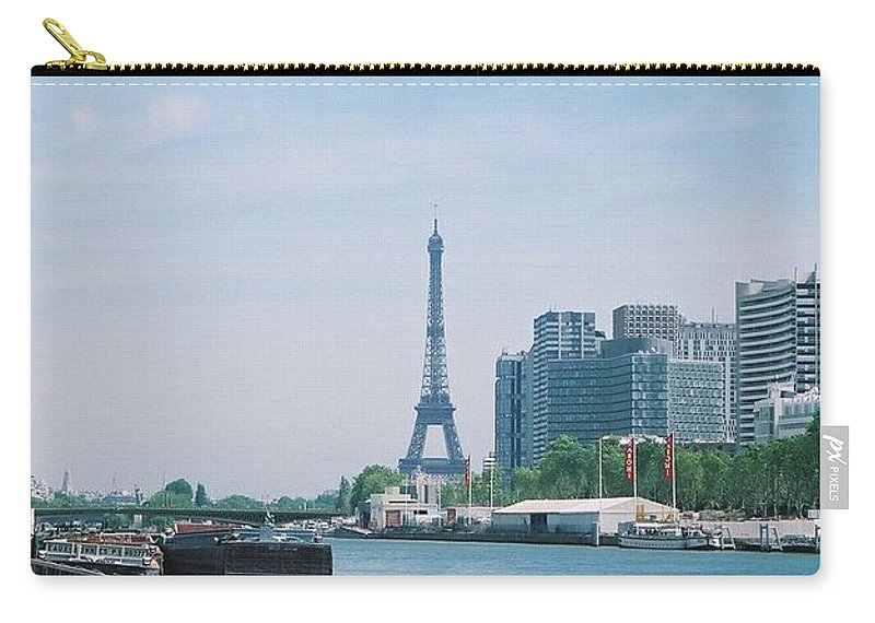 The Eiffel Tower Carry-all Pouch featuring the photograph The Eiffel Tower And The Seine River by Nadine Rippelmeyer