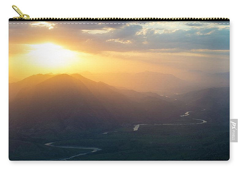 Barzan Carry-all Pouch featuring the photograph The Great Zab by Adam Mirani
