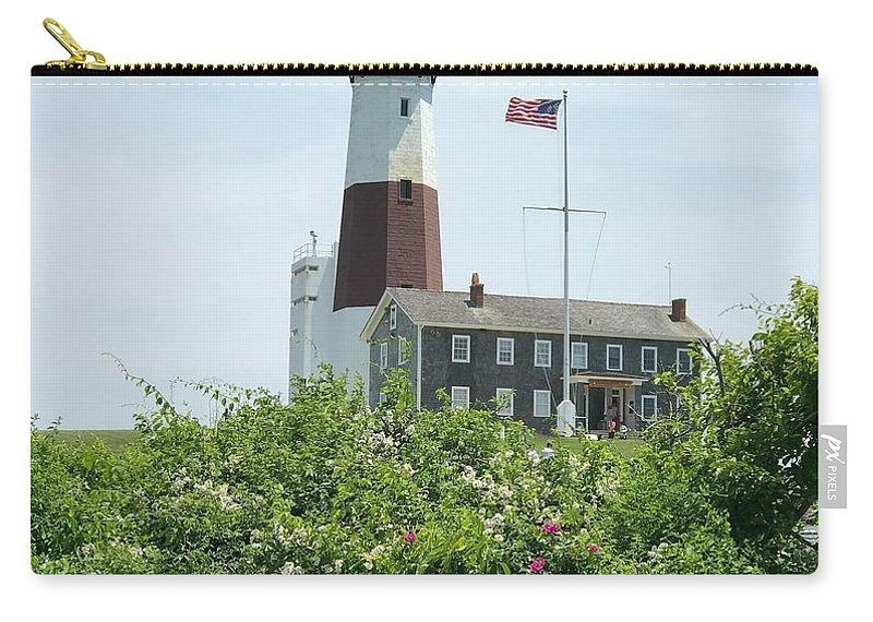 Lighthouse Carry-all Pouch featuring the photograph The Guiding Light by Jennifer Stark