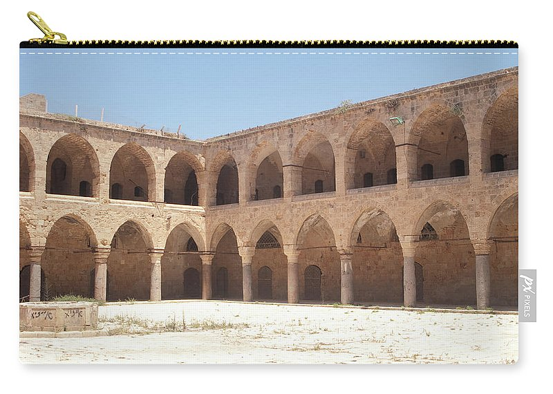 Khan Carry-all Pouch featuring the photograph The Khan, Also Known As A Caravanserai, In Akko, Israel by Adam Gladstone