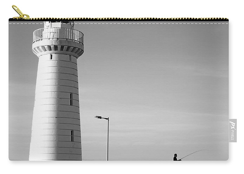 Architecture Carry-all Pouch featuring the photograph The Lihgthouse by Robert Navorol