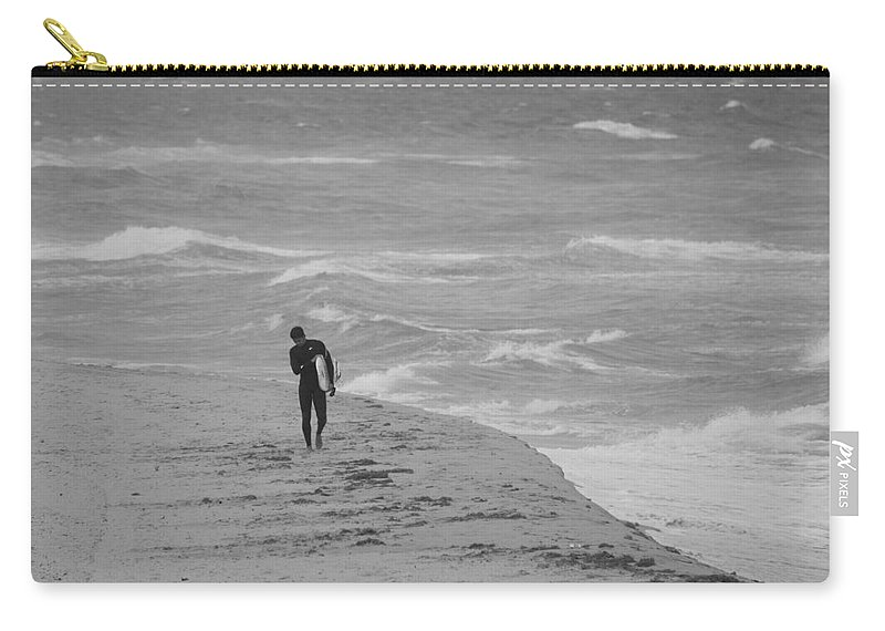 Black And White Carry-all Pouch featuring the photograph The Lonely Surfer Dude by Rob Hans