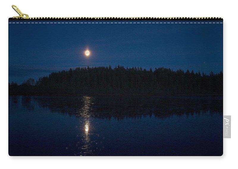 Lehtokukka Carry-all Pouch featuring the photograph The Moon Over Saari-soljanen by Jouko Lehto