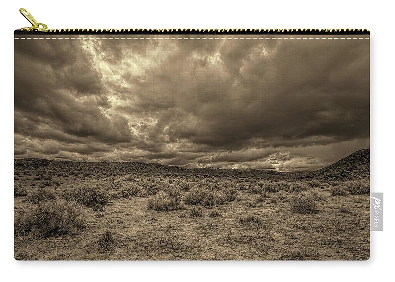 Clouds Carry-all Pouch featuring the photograph The Promise by Jim Buchanan