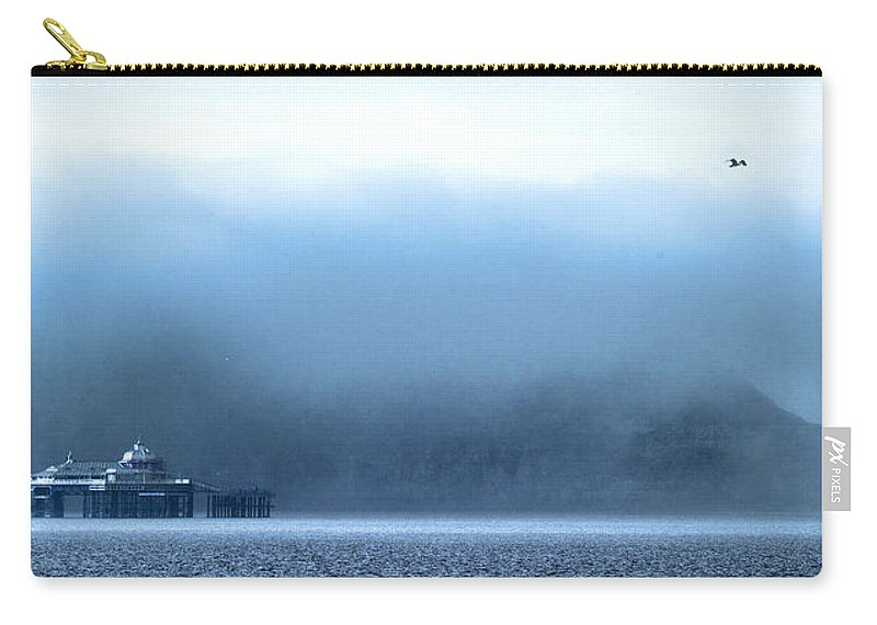 Pier Carry-all Pouch featuring the photograph The Sea Mist Lifts To Reveal The Great Orme Behind Llandudno Pier by Mal Bray