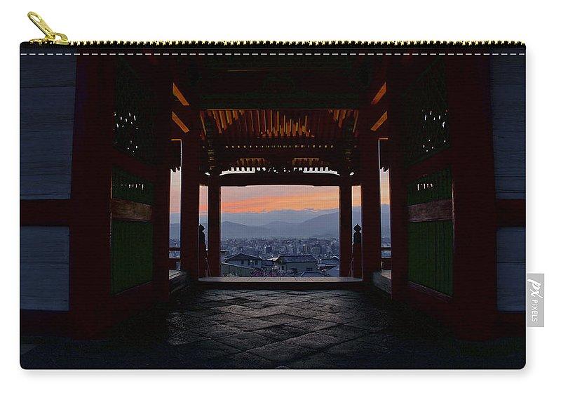 Kiyomizu-dera Carry-all Pouch featuring the photograph The Setting Sun And Kiyomizu-dera by Brian Kamprath