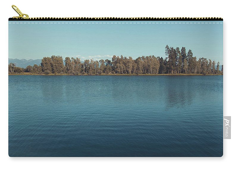 Landscape Carry-all Pouch featuring the photograph The Shore Of Flathead River by Isaac Passwater