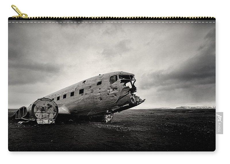 Solheimsandur Carry-all Pouch featuring the photograph The Solheimsandur Plane Wreck by Tor-Ivar Naess