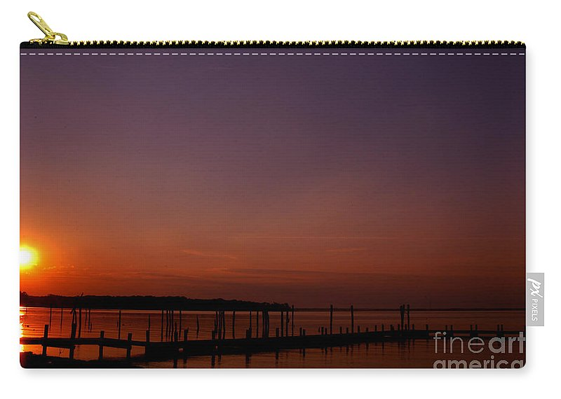 Clay Carry-all Pouch featuring the photograph The Sun Sets Over The Water by Clayton Bruster