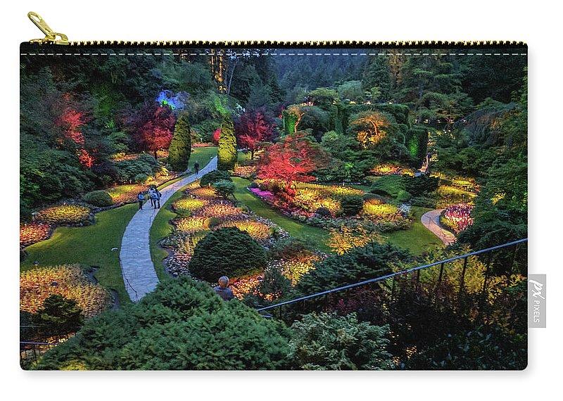 Butchart Gardens Carry-all Pouch featuring the photograph The Sunken Garden at dusk by Michael Bessler