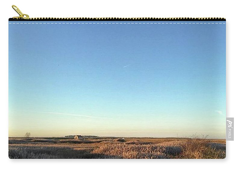 Natureonly Carry-all Pouch featuring the photograph Thornham Marsh Lit By The Setting Sun by John Edwards