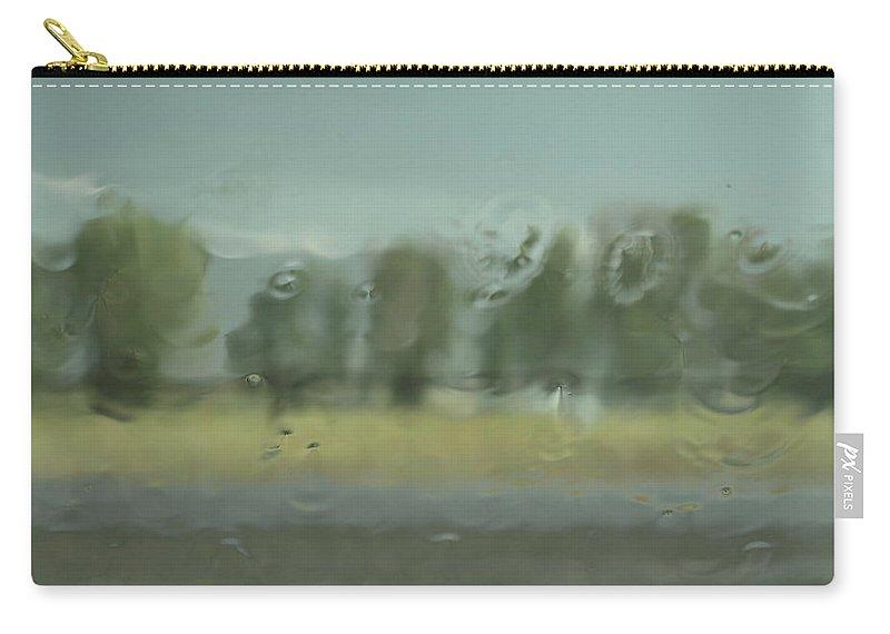 Rain Carry-all Pouch featuring the photograph Through The Rain by DeeLon Merritt
