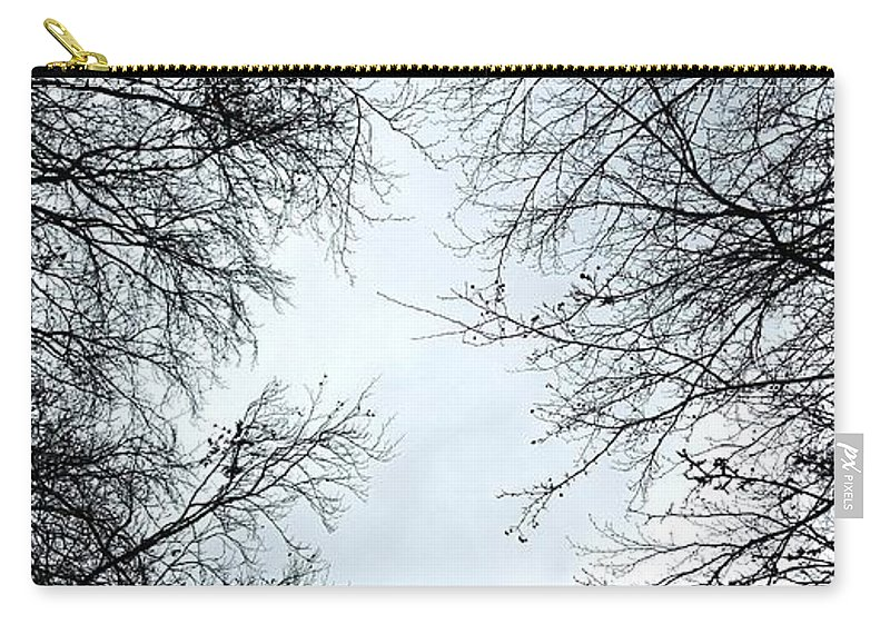Crow. Bird. Trees. Woods. Woodland. Flying. Carry-all Pouch featuring the photograph Through The Trees by Nicholas Rainsford