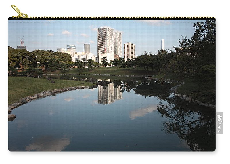 Tokyo Carry-all Pouch featuring the photograph Tokyo Highrises With Garden Pond by Carol Groenen