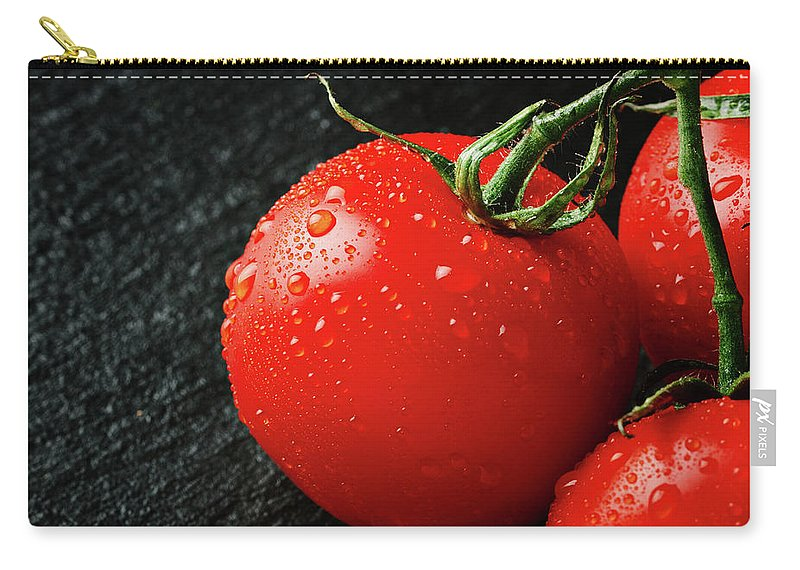 Background Carry-all Pouch featuring the photograph Tomatoes Close Up On Black Slate by Tatiana Frank