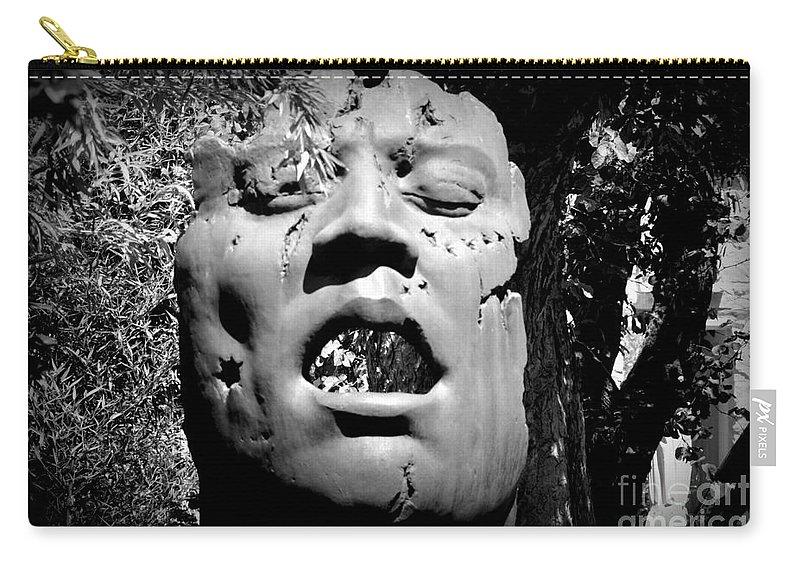 Outdoor Sculpture Carry-all Pouch featuring the photograph Torn by Bernd Billmayer