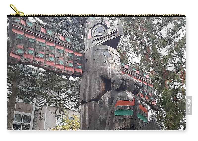 City Of Totems Carry-all Pouch featuring the photograph Totem by Les Polgar