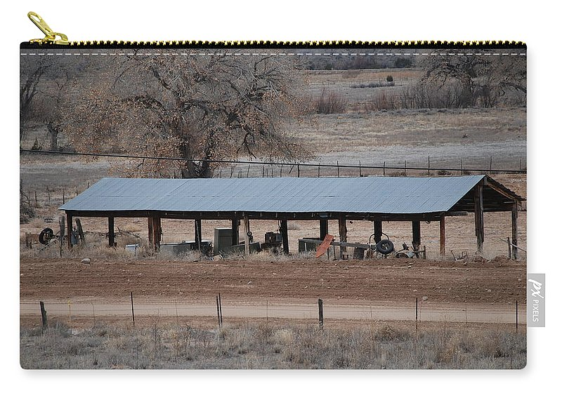 Architecture Carry-all Pouch featuring the photograph Tractor Port On The Ranch by Rob Hans