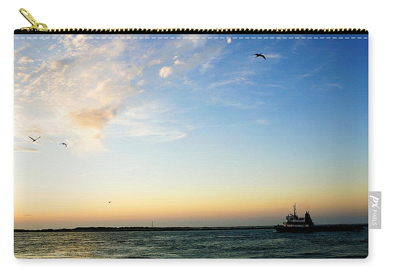 Sip Carry-all Pouch featuring the photograph Travels At Sunset by Marilyn Hunt