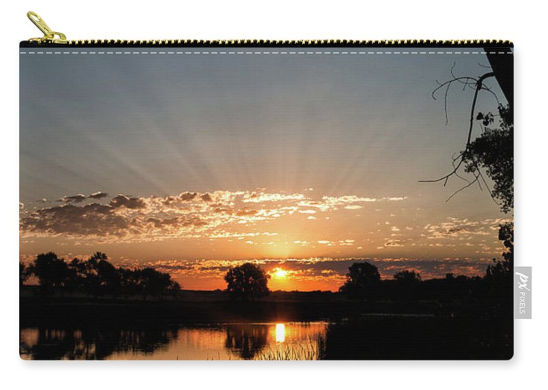 Sunrise Carry-all Pouch featuring the photograph Trees Frame A Great Plains Sunrise by Tony Hake