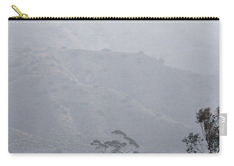 Linda Brody Carry-all Pouch featuring the photograph Trees In Early Morning Mist With Tower by Linda Brody
