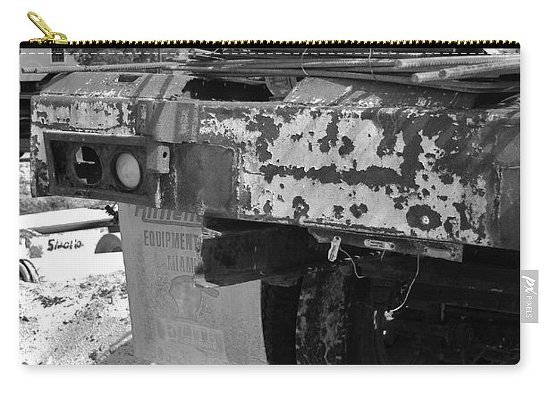 Black And White Carry-all Pouch featuring the photograph Trucks And Sky by Rob Hans