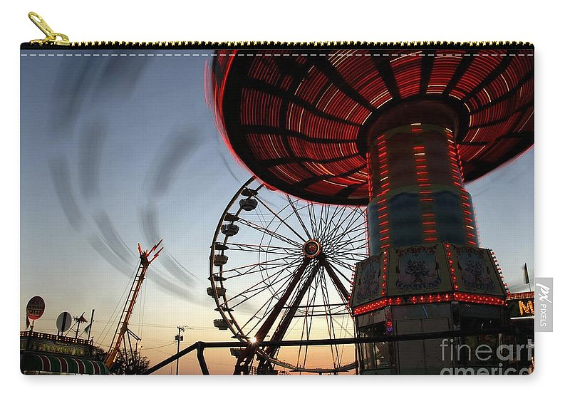Fair Carry-all Pouch featuring the photograph Twirling Away by David Lee Thompson