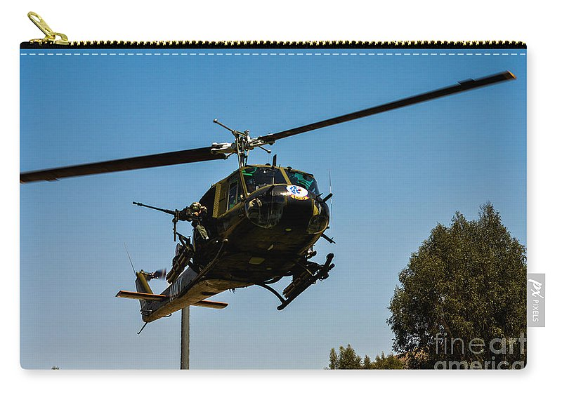 Bell Uh-1 Huey Carry-all Pouch featuring the photograph Uh-1 Huey Arrival by Tommy Anderson