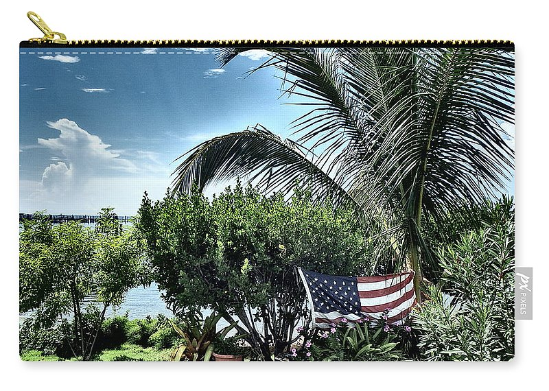 Amerian Flag Carry-all Pouch featuring the photograph US Flag in the Abaco Islands, Bahamas by Cindy Ross