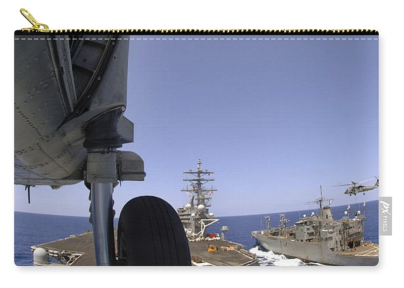 Adults Only Carry-all Pouch featuring the photograph U.s. Navy Petty Officer Leans by Stocktrek Images