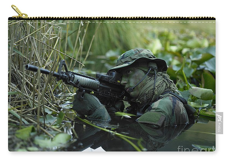 Special Operations Forces Carry-all Pouch featuring the photograph U.s. Navy Seal Crosses Through A Stream by Tom Weber