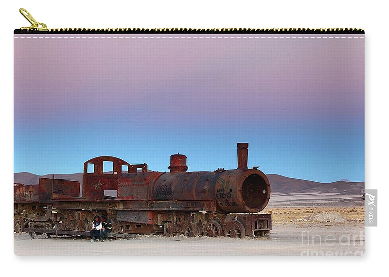 Steam Engine Carry-all Pouch featuring the photograph Uyuni Train Cemetery At Sunset by James Brunker