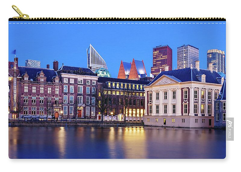 The Hague Carry-all Pouch featuring the photograph View Of Mauritshuis And The Hofvijver - The Hague by Barry O Carroll