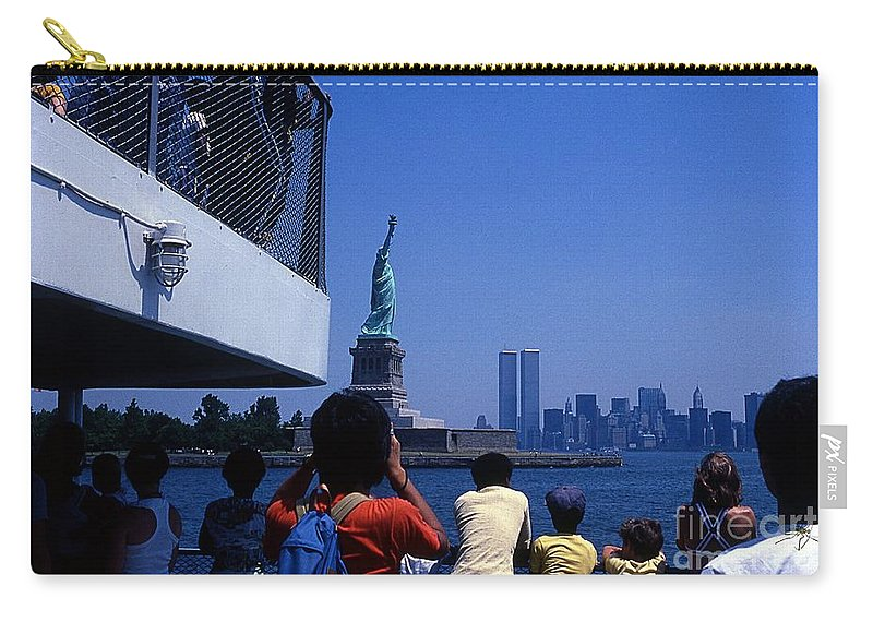 Statue Of Liberty World Trade Center Ferry Tourists Skyline Carry-all Pouch featuring the photograph View Of Statue And Towers by Bob Bennett