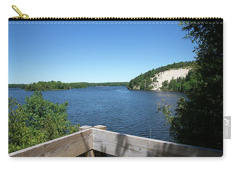 Au Sable River Carry-all Pouch featuring the photograph View On The Au Sable by Linda Kerkau