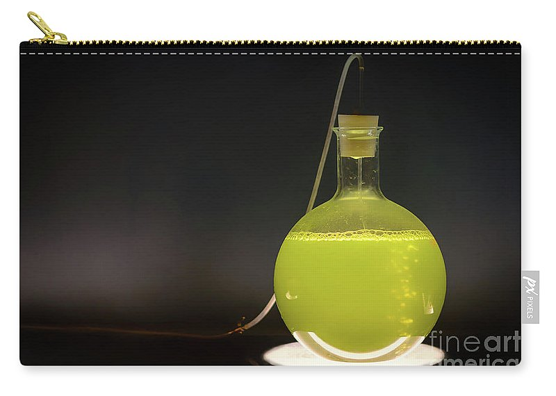 Acid Carry-all Pouch featuring the photograph Volumetric Flask With Green Liquid Chemical Experiment by Sasha Samardzija