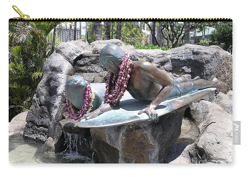 Statue Carry-all Pouch featuring the photograph Waikiki Statue - Surfer Boy And Seal by Mary Deal