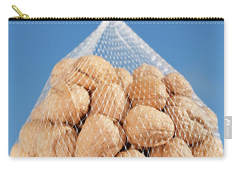 Walnuts Carry-all Pouch featuring the photograph Walnuts by Gaspar Avila