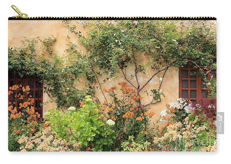 Carmel Mission Carry-all Pouch featuring the photograph Warm Colors In Mission Garden by Carol Groenen
