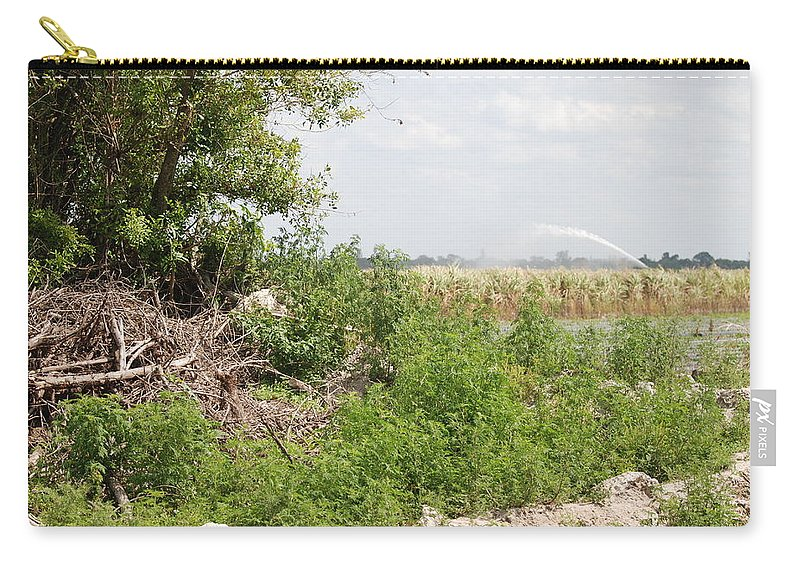 Leaves Carry-all Pouch featuring the photograph Watering The Weeds by Rob Hans