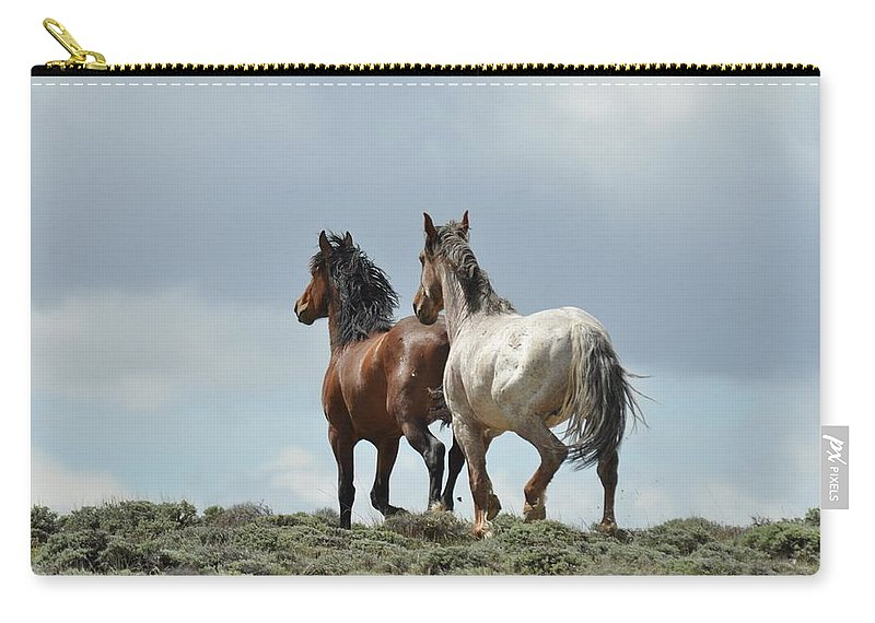 Wild Horses Carry-all Pouch featuring the photograph We Will Be Over the Hill in a Few Seconds by Frank Madia