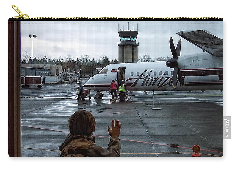 Airplane Carry-all Pouch featuring the photograph Welcome Home by Donna Blackhall