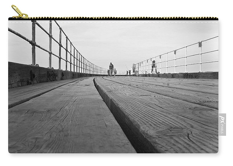 Whitby Pier Carry-all Pouch featuring the photograph Whitby Pier by Svetlana Sewell