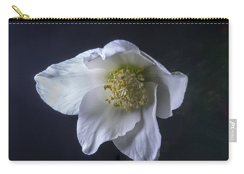 Helleborus Carry-all Pouch featuring the photograph White Helleborus Bloom by Douglas Barnett